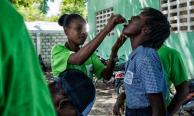 A health worker administering the oral cholera vaccine in Arcahaie, Haiti. UN Photo/Logan Abassi