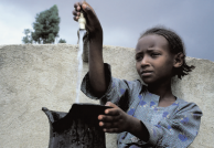 Little girl practices safe hand washing