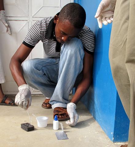 Conducting a rapid cholera test in an informal setting in Zanzibar. Photo: Lorenz Von Seidlein (2010)